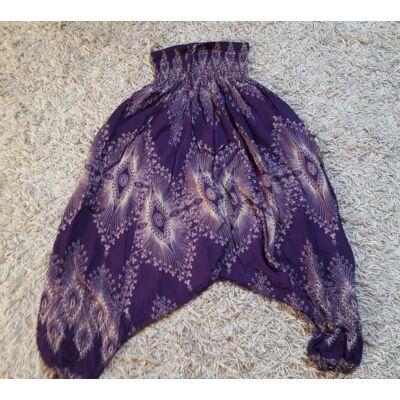 Buggyos Aladdin nadrág lila alapon bézs szem mintázattal