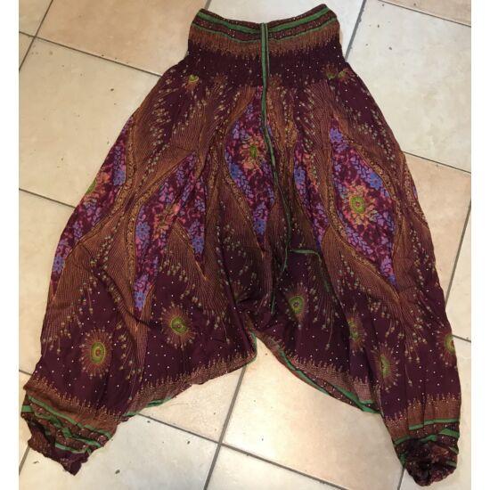 Buggyos Aladdin nadrág bordó-barna alapszínű mély ülepű pávatoll mintázattal